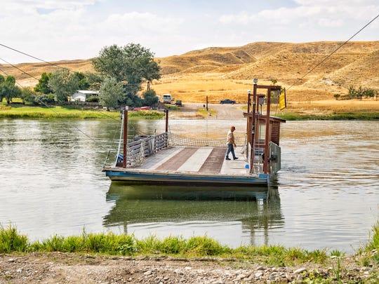 Brian Perkins pilots the Carter ferry across the Missouri River.