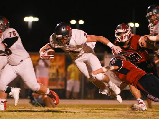 Satellite's Beau Cole (2) is brought down midair by Cocoa Beach's Ryan Tsarnas (1).