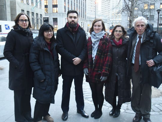 Ahmad Awad, center, with other Fordham students and