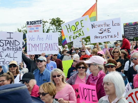 Thousands rally along the Eau Gallie Causeway during the 2018 Women's March