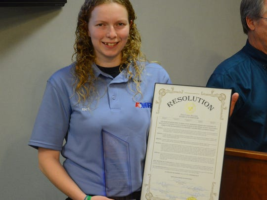 The Hinds County Board of Supervisors honored Courtney Tullos with a resolution after she pulled a paraplegic man from a burning van.