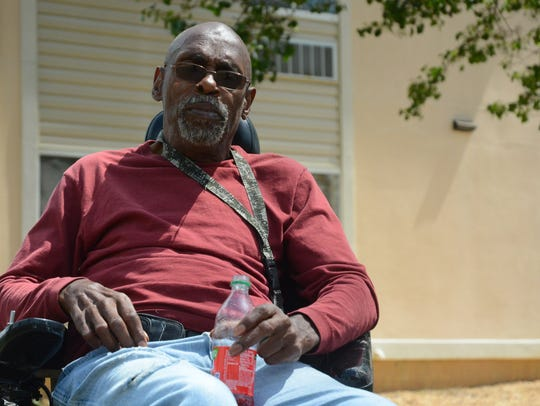 Sixty-five-year-old Cleveland Trussell gets some fresh air outside of Jackson Run Apartment on April 2, 2018. Trussell, who uses a motorized wheelchair to get around, said the last time the apartment's elevator was broken, he was stuck on the second floor until it was fixed - about a month later.