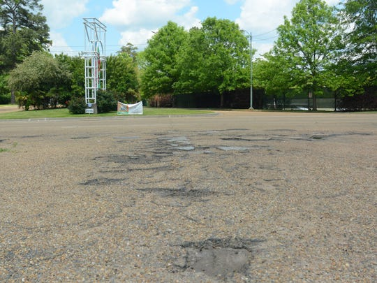 A series of potholes near the intersection of West Capitol Street and Moss Avenue lie in the way of motorists on April 27, 2018. The location is directly across the street from the entrance to the Jackson Zoo.