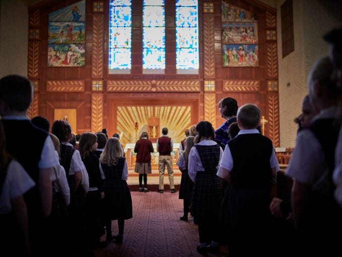 St. Martha schoolchildren attend a mass at the church