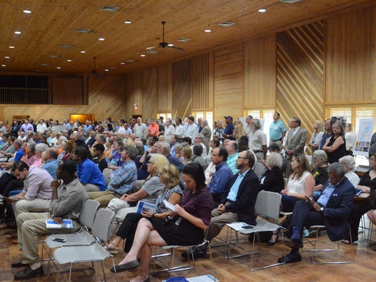 In this July 2018 file photo, a crowd packs a public hearing to address concerns of the proposed One Lake Project at the Sparkman Auditorium at the Mississippi Agriculture and Forestry Museum.