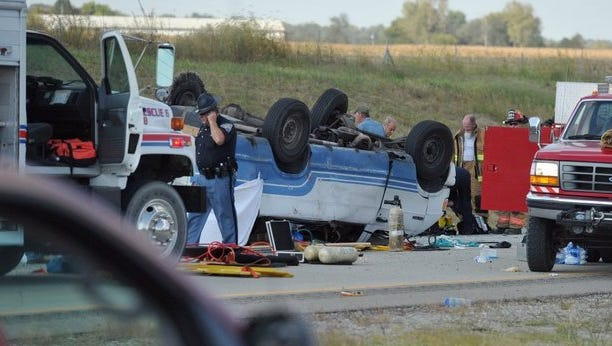 Emergency crews respond to a 2015 van rollover on Interstate 69 that killed two immigrant factory workers.