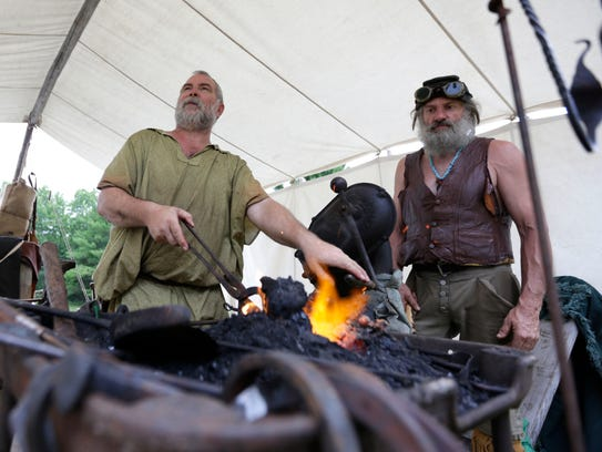 Blacksmiths heat metal during the Forts Folle Avoine
