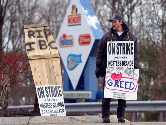 Striking worker Joe Locey pickets outside a Hostess