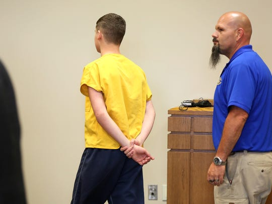 James 'Austin' Hancock leaves the courtroom after being sentenced to a juvenile facility until he turns 21. Adult prison is possible if he misbehaves.