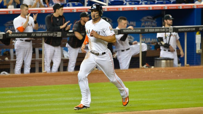 Giancarlo Stanton scores a run during the sixth inning.