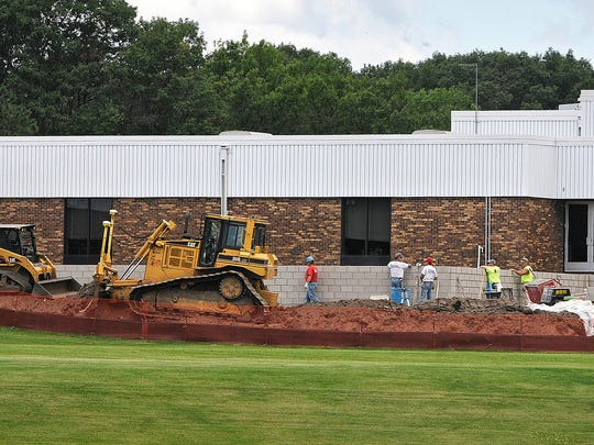 Construction crews work on a portion of new classroom additions at Sartell Middle School in 2014.