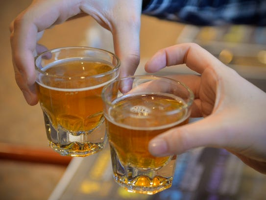 Participants toast each other with Insight Brewing's