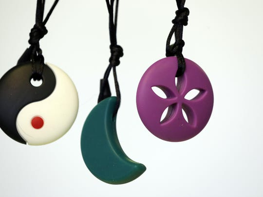 Silicone teethers and sensory relief toys by Zen Rocks are displayed at the New York Baby Show.