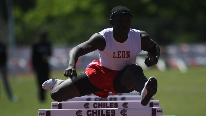 Leon senior Justin Peter runs the 300 hurdles during Saturday's Chiles Capital City Track & Field Classic. Peter ran Class 3A's second best time a week ago, putting him in the running for a state title.