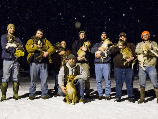 From left, Brent Witters with Finn, Jake Rowe with Knox, Joe Gruber with Bear, Logan Wolf with Rosie, Mitchel Craddock with Brimmie, Trevor Jennings with Gunner, David Perkins with Daisy and Doug Craddock, front, with the mother of the litter, Annie, pose on Dec. 14, 2016.