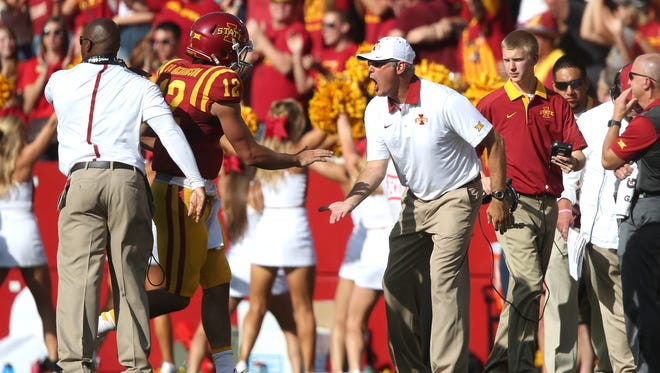 Iowa State quarterback Sam Richardson celebrates a touchdown pass with head coach Paul Rhoads during the Cy-Hawk series on Saturday, Sept. 12, 2015, at Jack Trice Stadium in Ames, Iowa.