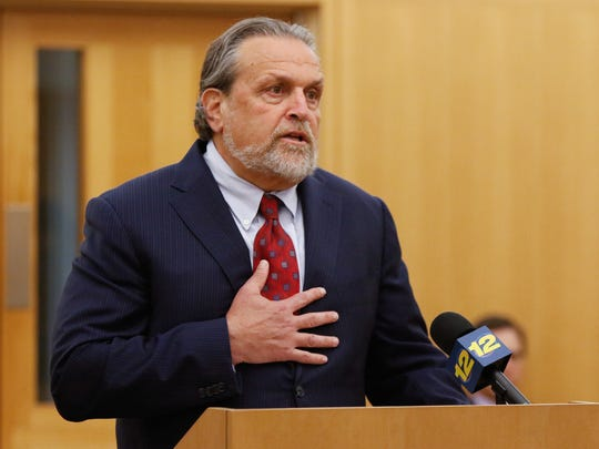 Dr. Dennis Charney reads a victim impact statement prior to the sentencing of Hengjun Chao by Judge Barry Warhit in Westchester County Court in White Plains on Wednesday, Aug. 9, 2017.