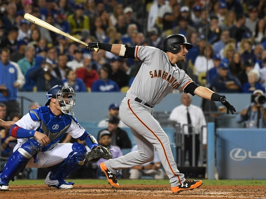 San Francisco Giants second baseman Joe Panik hits a single against the Los Angeles Dodgers in the 5th inning at Dodger Stadium on Sept. 22.