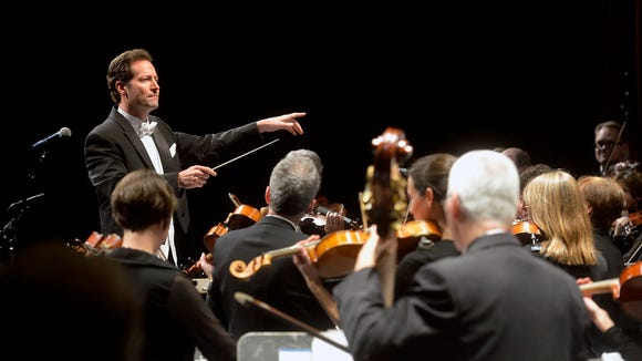 Lawrence Golan directs 77 musicians performing in his inaugural concert as conductor of the York Symphony Orchestra on Saturday, Oct. 18, 2014. The concert featured