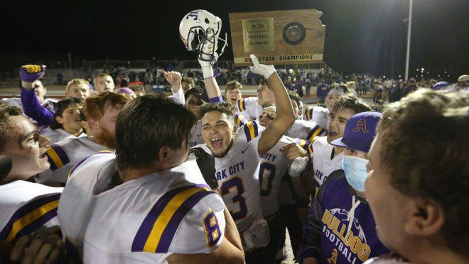 Arkansas City players celebrate their 28-27 win over McPherson in the Class 4A state semifinal game Friday night in McPherson.