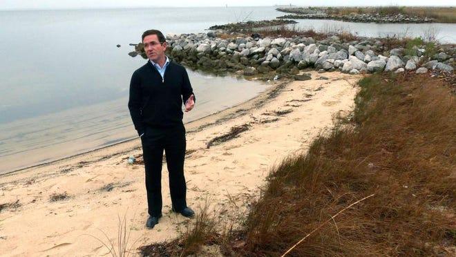 Pensacola City Councilman Brian Spencer, shown standing on Bruce Beach.