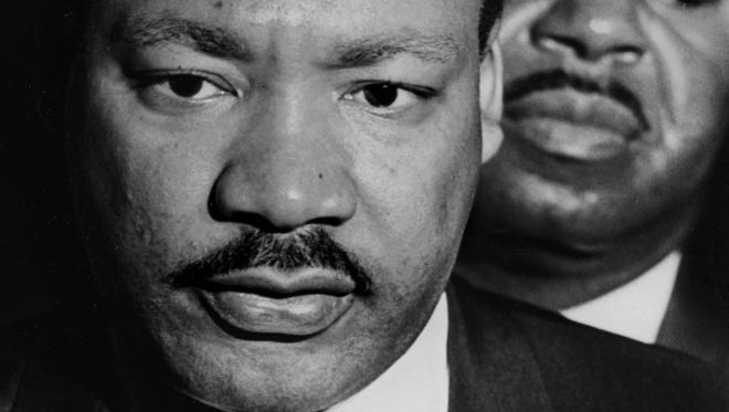 Martin Luther King arrives at the Memphis airport on April 3, 1968, under pressure for being associated with the violence of the previous week's march-turned-riot in Memphis, but determined to support the city's striking sanitation workers. Behind him is aide Ralph Abernathy.