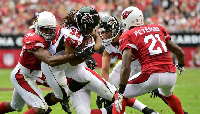 The Cardinals' swarming defense has helped cover for an offense that has sputtered at times.