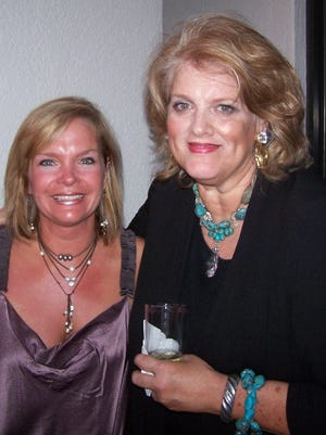 Libby Murphy, right, poses with artist and art teacher Libby Lynch at the Pat Kerr Tigrett Men's Committee party in May 2010.