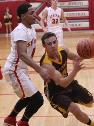 Old Fort's Jacob Webb drives to the basket against SJCC's Mikey Moore.