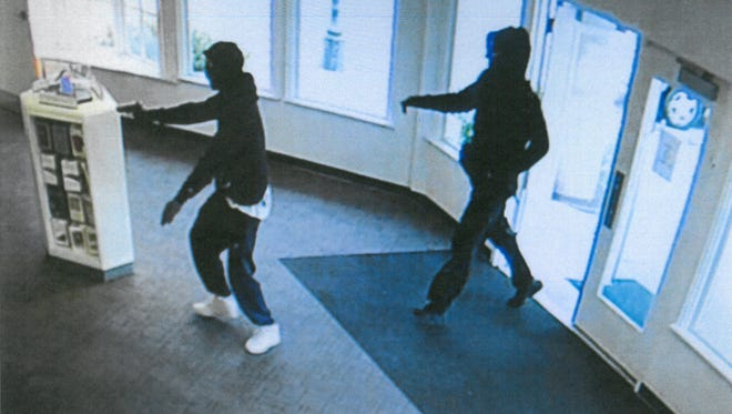 This image from a surveillance video shows two suspects robbing an AT&T store at 11000 N Port Washington Road in Mequon.