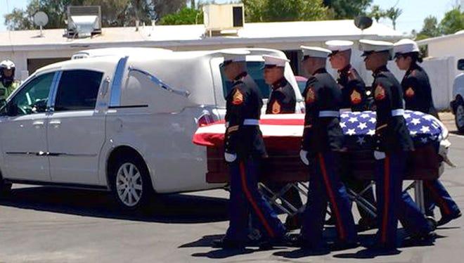 A group of Marines help unload Jake Hug's casket on May 30, 2015.