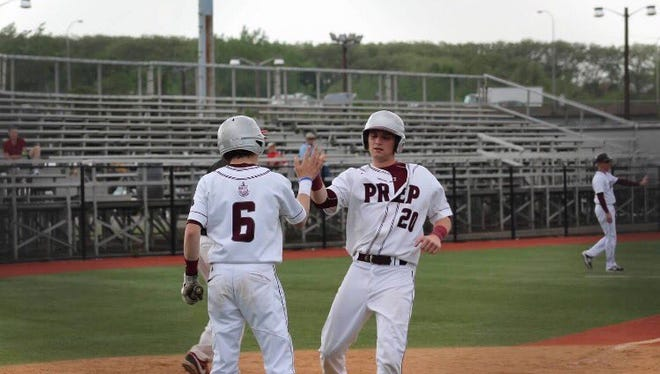 Daniel Cooney, right, playing baseball for St. Peters's Prep in Jersey City.