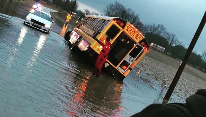 Harrison High School students on this bus are safe after their school bus washed off the road Wednesday morning.