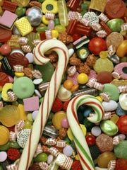 High angle view of candies with two candy canes