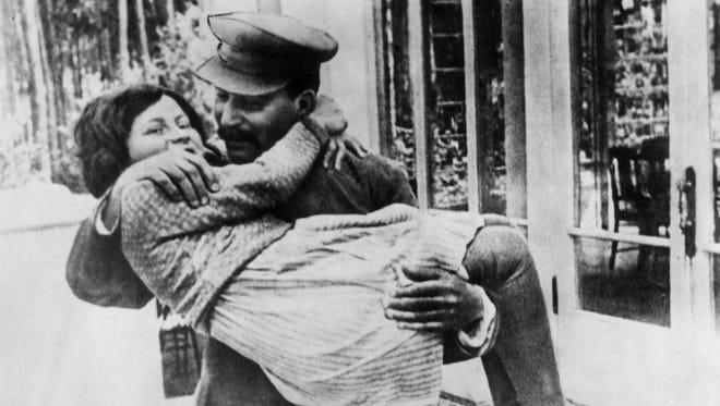 This 1936 file photo shows Joseph Stalin holding his daughter Svetlana Alliluyeva Stalin. Joseph Stalin's daughter, Svetlana, lived briefly in the East Berlin area after defecting.