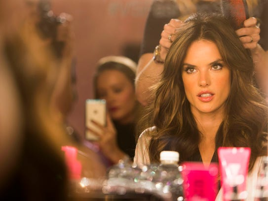 Alessandra Ambrosio gets styled backstage before the