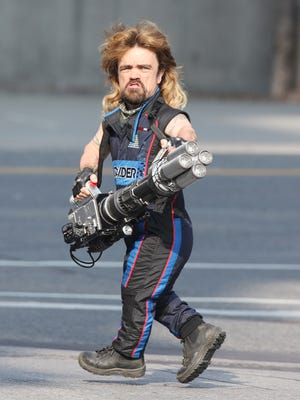 MUST NEGOTIATE THE RATE WITH ONE TIME RIGHTS  FOR USATODAY.COM ONLY--RAS  123821, EXCLUSIVE: Peter Dinklage seen holding what appears to be a huge bazooka while filming his new movie 'Pixels' in Toronto. Toronto, Canada - Monday August 04, 2014. Photograph: © PacificCoastNews. Los Angeles Office: +1 310.822.0419 London Office: +44 208.090.4079 sales@pacificcoastnews.com FEE MUST BE AGREED PRIOR TO USAGE  CREDIT:PacificCoastNews [Via MerlinFTP Drop]