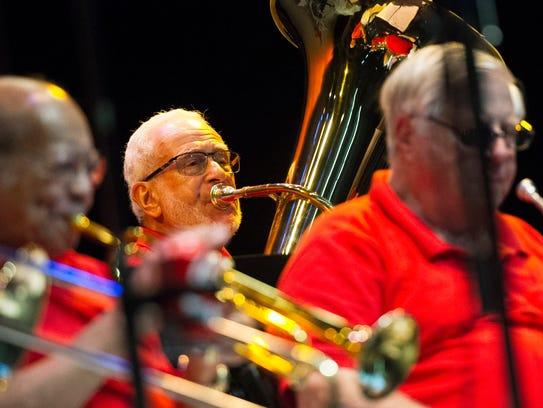 Tuba player Art Blatt (center) performs Dixieland Jazz