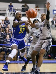 Delaware's Nicole Enabosi throws a pass around Georgetown's Cynthia Petke in the WNIT at Georgetown last season.