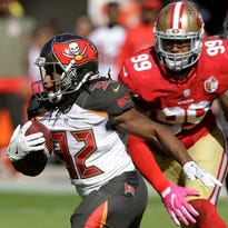 Buccaneers running back Jacquizz Rodgers, left, has topped 100 yards in his past two games.