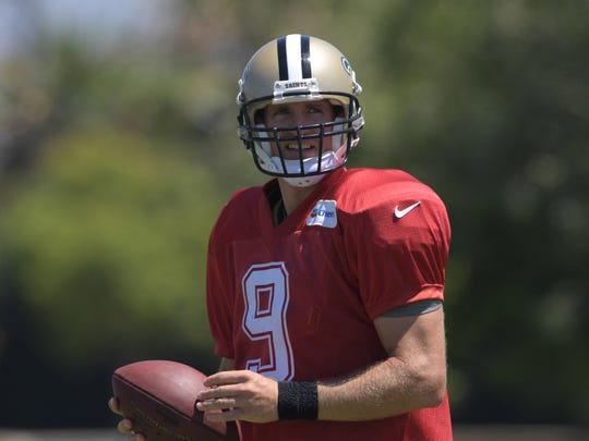 Aug 17, 2017; Costa Mesa, CA, USA; New Orleans Saints quarterback Drew Brees (9) reacts holds a football during practice at the Jack Hammett Sports Complex. Mandatory Credit: Kirby Lee-USA TODAY Sports