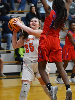 Randleman's Gracyn Hall, shown here in action against T. Wingate Andrews last season, scored 21 points in the Tigers' win on Tuesday. [PAUL CHURCH/ THE COURIER-TRIBUNE]