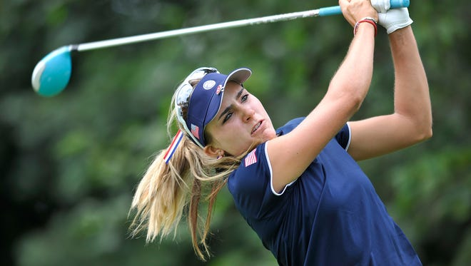 Lexi Thompson follows through on a drive on the 7th hole during the first round of the International Crown LPGA golf tournament Thursday, July 24, 2014, in Baltimore.