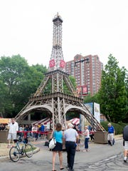 The replica Eiffel Tower is a mainstay at Bastille Days, held in Cathedral Square Park July 12-15.