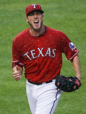 Joe Nathan reacts after recording the game's final out.