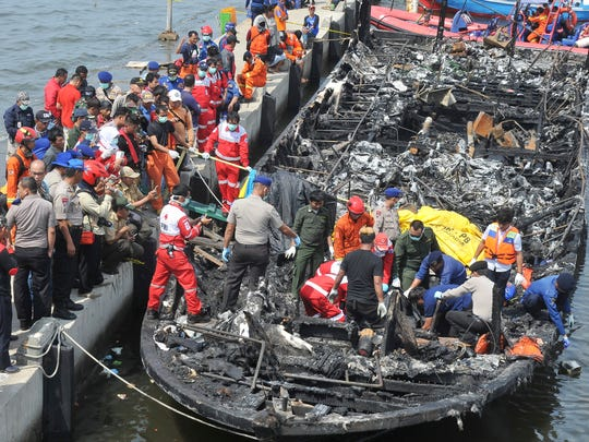 Rescuers search for victims from the wreckage of a