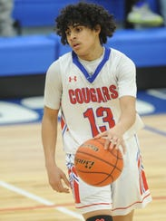 Cooper point guard Noah Garcia brings the ball up court