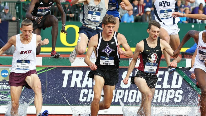 Furman's Troy Reeder, center, earned first team All-American honors after finishing seventh in the 3,000-meter steeplechase at the NCAA Outdoor Track and Field Championships in Eugene, Oregon.