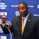 New Syracuse University football coach Dino Babers speaks with the media during his introductory news conference. He's SU's 30th head coach.
