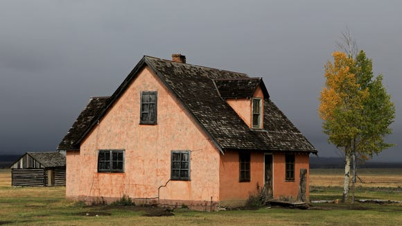 """The """"Pink House"""" at the John Moulton homestead is part of the historic Mormon Row district in Wyoming's Grand Teton National Park."""